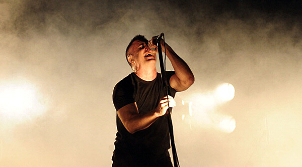 Trent Reznor of the of the US alternative band Nine Inch Nails performs during the first day of the Mexican musical festival Vive Latino at the Foro Sol in Mexico City, on March 27, 2014. AFP PHOTO/Alfredo ESTRELLA        (Photo credit should read ALFREDO ESTRELLA/AFP/Getty Images)