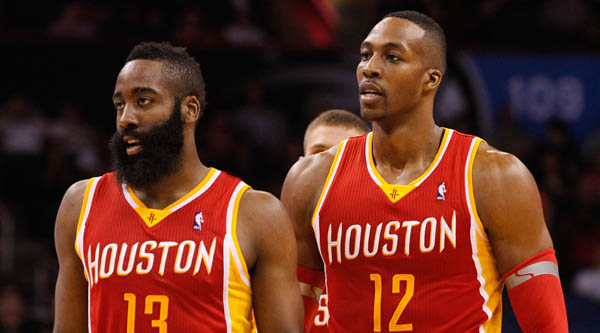 Mar 5, 2014; Orlando, FL, USA; Houston Rockets shooting guard James Harden (13) and Houston Rockets center Dwight Howard (12) against the Orlando Magic  during the second half at Amway Center. Houston Rockets defeated the Orlando Magic 101-89. Mandatory Credit: Kim Klement-USA TODAY Sports