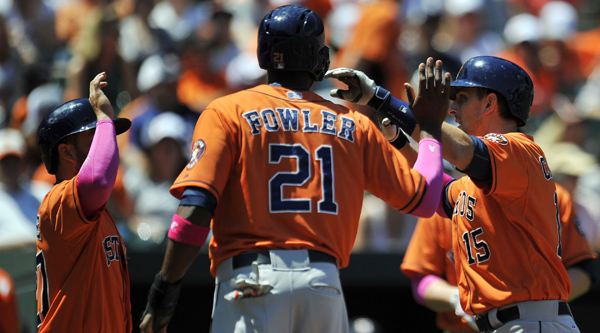 May 11, 2014; Baltimore, MD, USA; Houston Astros designated hitter Jason Castro (15) is congratulated by Dexter Fowler (21) and Jose Altuve (27) after hitting a three-run home run in the first inning against the Baltimore Orioles at Oriole Park at Camden Yards. Mandatory Credit: Joy R. Absalon-USA TODAY Sports