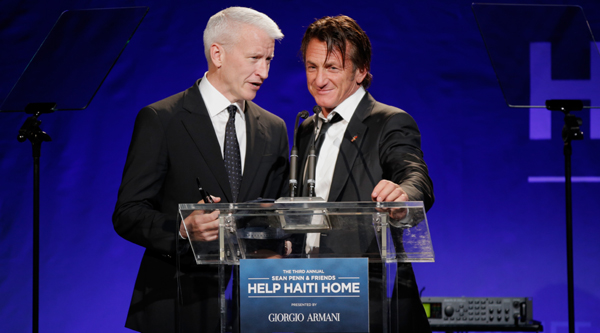 BEVERLY HILLS, CA - JANUARY 11:  Anderson Cooper and Sean Penn speak onstage during the 3rd annual Sean Penn & Friends HELP HAITI HOME Gala benefiting J/P HRO presented by Giorgio Armani at Montage Beverly Hills on January 11, 2014 in Beverly Hills, California.  (Photo by Joe Scarnici/Getty Images for J/P Haitian Relief Organization)