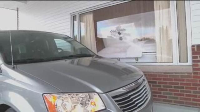 A funeral home offers drive-thru viewing window