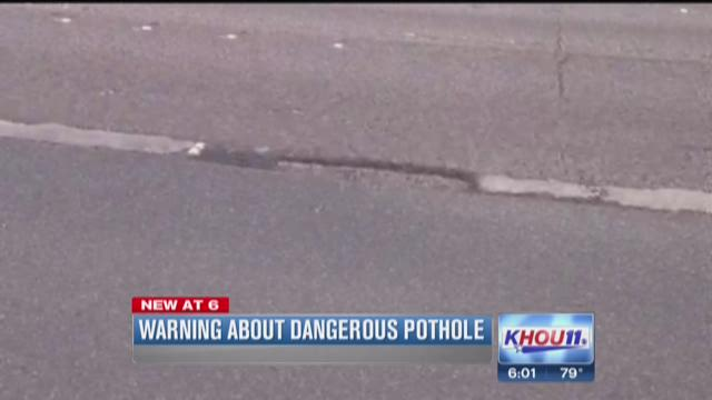 Warning about dangerous pothole