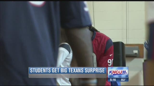 Texans players surprise students