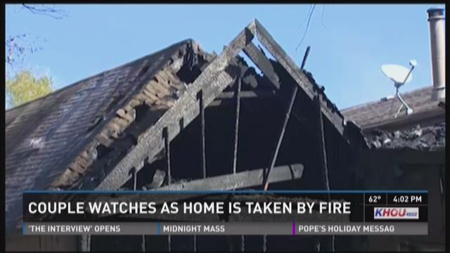 Couple watches as home is destroyed by fire