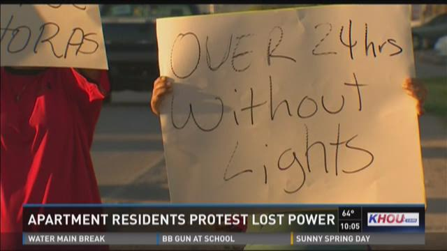 Apartment residents took to the streets to get management