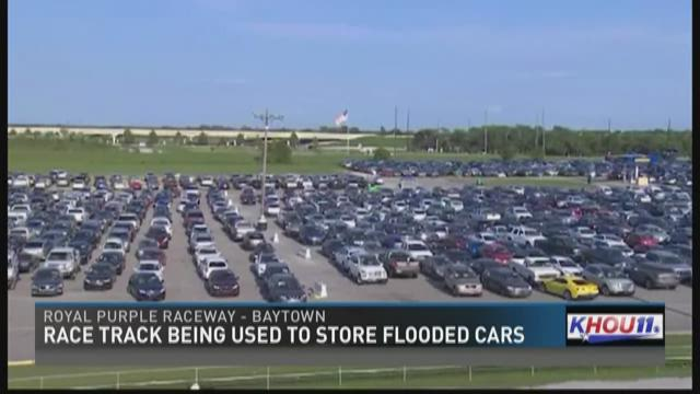 Race track being used to store flooded cars for Royal motors houston tx
