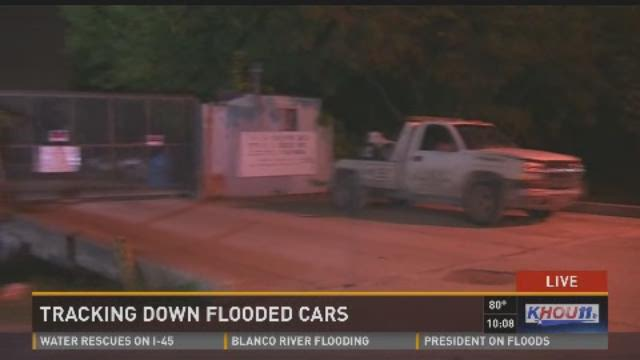 Locals reclaim flooded vehicles from tow lots
