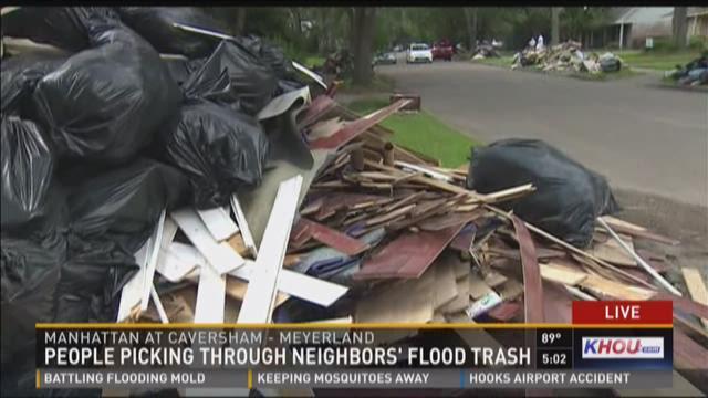 Neighbors' upset after strangers pick through flood trash