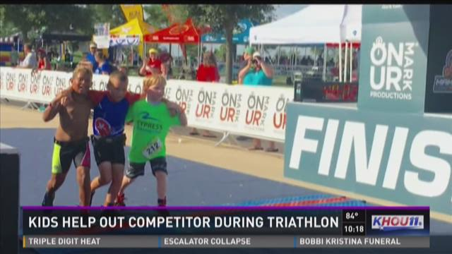 Young boys help competitor during Cypress triathlon