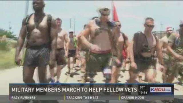Military members march  to help fellow vets