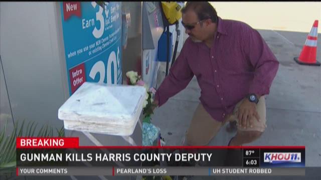 Locals create memorial for deputy at Chevron gas pump