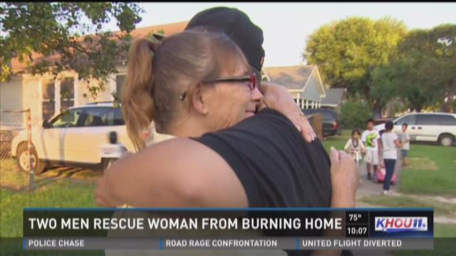 Two men hailed as heroes for rescuing woman from burning home
